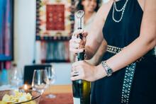 Woman Opening Wine Bottle Duri...