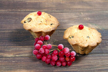 Two Cupcakes With Red Berries On A Wooden Table Close Up