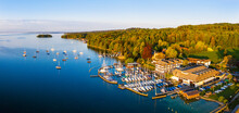 Germany, Bavaria, Poecking, Drone View Of Sailboats Moored In Marina On Forested Shore Of Lake Starnberg In Spring