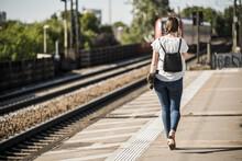 Woman With Skateboard Walking ...
