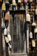 View Of Old Lobster Buoys Hanging Outside Hotel Door