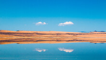 Scenic View Of Clouds Reflecti...