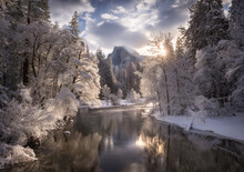 Scenic View Of Half Dome And Yosemite Valley With Merced River During Winter
