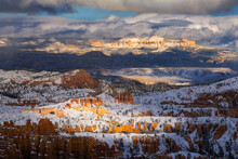 High Angle View Of Snow Covered Hoodoos In Valley During Sunrise