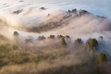 High Angle View Of Fog Over Forest During Sunrise