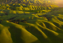 Aerial View Of Rolling Hills During Sunrise