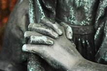 Hands Of A Praying Statue Close Up
