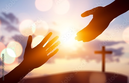 Obraz Silhouette of human hands helping to enother hands - fototapety do salonu