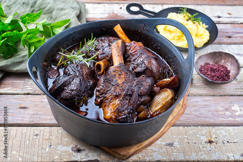 Fotografie, Obraz Modern style traditional braised slow cooked lamb shank in red wine sauce with s
