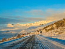 Driving At Golden Sunrise Thro...