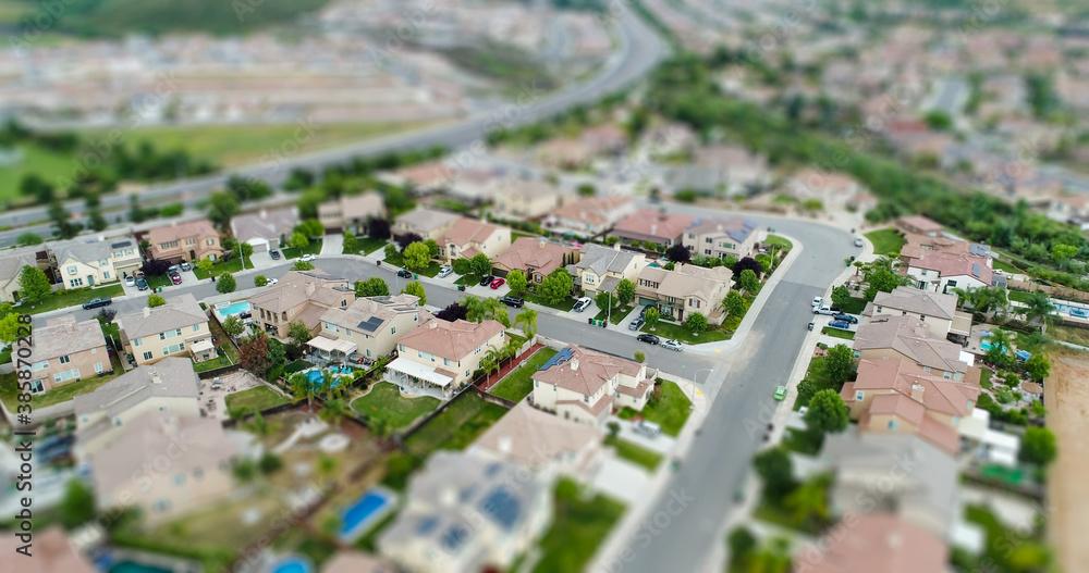 Fototapeta Aerial View of Populated Neigborhood Of Houses With Tilt-Shift Blur