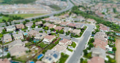 Obraz Aerial View of Populated Neigborhood Of Houses With Tilt-Shift Blur - fototapety do salonu