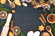 Christmas Tree, Gingerbread Cookies, Spices, Baking Supplies On Black Wood Background. Christmas, New Year Greeting Card