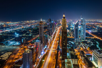Arial view of Dubai cityscape at night with beautiful lights