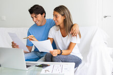 Young Happy People Looking At Laptop, Building Family Financial Plan, Meal Planning For Healthy Style, Wedding Ideas, Ordering Gifts, Free Online Courses To Get Diploma. Man Working In Home Office