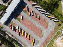 An Aerial Top Down View Of A Bus Depot With Numbers Of Buses Park Inside
