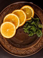 Sliced Oranges Lie On A Plate ...