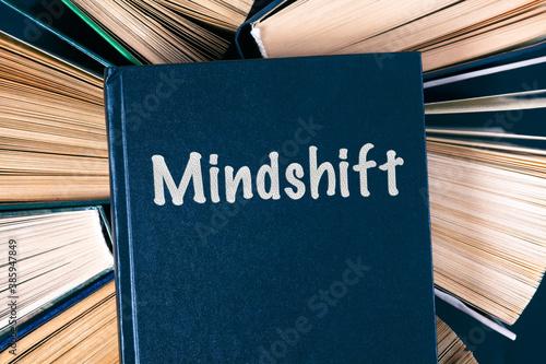 Fotografija Old hardback books with book Mindshift on top.