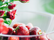 Closeup Of Sweet Strawberries In Transparent Bowl