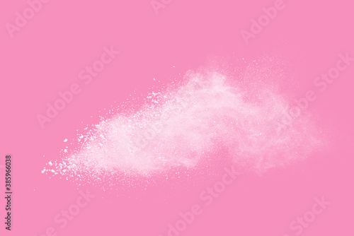 White powder explosion on pink background. Paint Holi.
