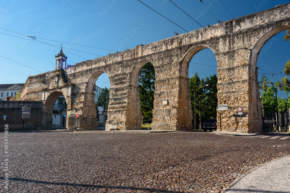 Fototapeta landmarks of Portugal -view of the roman acquedcut in old town of Coimbra. summer 2019