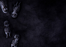 Halloween Background With Decorative Black Spider Web And Skeletons In It. Artificial Black Web For The Halloween Village. Space For Text, Frontal View.