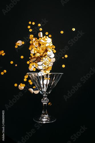 Fotografija Wine glass with gold sparkles