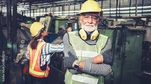 Obraz Senior factory worker or engineer close up portrait in factory . Industry and engineering concept . - fototapety do salonu