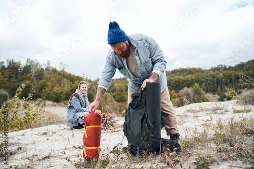 Man pulling a tent Wallpaper Mural