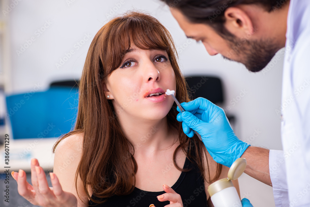 Fototapeta Young woman visiting male doctor dermatologist