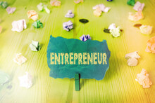 Word Writing Text Entrepreneur. Business Photo Showcasing One Who Organizes And Assumes The Risks Of A Business Colored Crumpled Rectangle Shaped Reminder Paper Light Blue Background