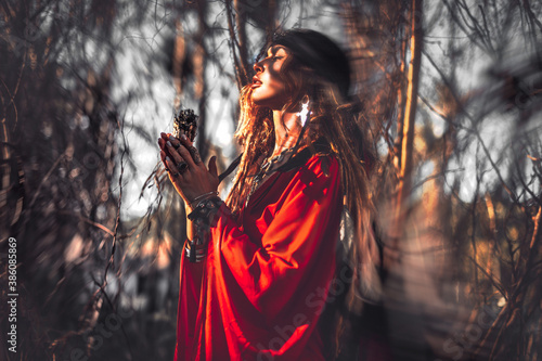 Fototapeta beautiful young woman with shamanic fire outdoors obraz
