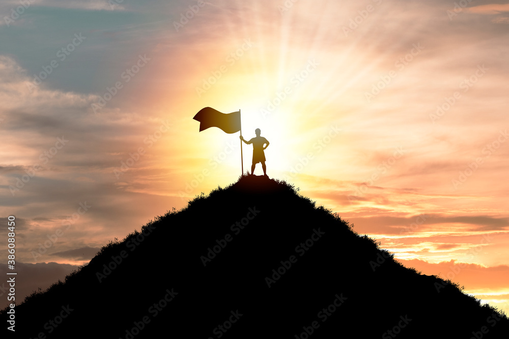 Fototapeta Business achievement objective  target and successful  concept , Silhouette Man standing and holding flag on top of mountain with cloud sky and sunlight.