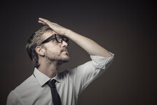 Stressed Frustrated Businessman Making A Facepalm Gesture