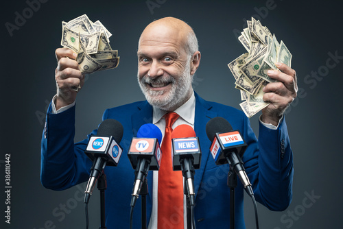 Fotografia, Obraz Greedy politician holding cash money