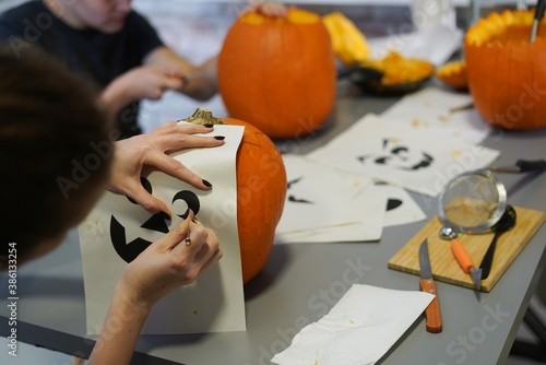 Obraz Making halloween pumpkin head jack o lantern at home. Do it yourself. - fototapety do salonu