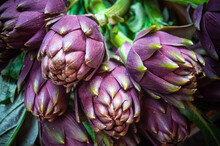 Artichokes For Sale On A Market Stand In A Local Italian Market
