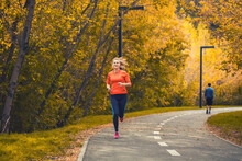 Woman Athlete On A Morning Jog...