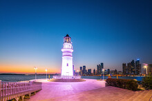 White Lighthouse And Urban Arc...