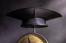 A  Close Up Image Of An Antique Penny Weighing Scale