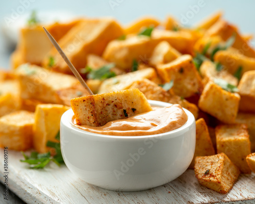 Canvas-taulu Patatas bravas traditional Spanish potatoes snack tapas on white wooden board