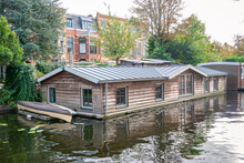 Wooden Houseboats In A Canal I...