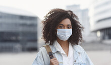 Young Woman Wearing Protective Face Mask In A City, Masked African Teenage Student Girl On A City Street,  Epidemic, Pandemic, Corona Virus Protection, Healthy Lifestyle, People Concept