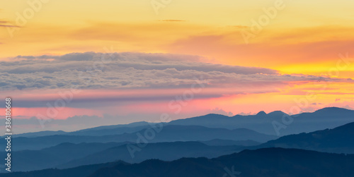 The sunrise seen from the top of Monte Falco in the Apennine mountain range. #386180668