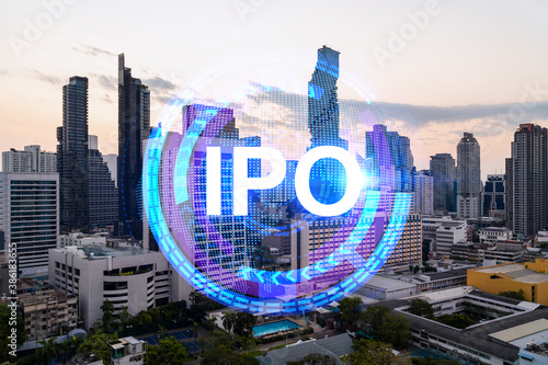 Hologram of IPO glowing icon, sunset panoramic city view of Bangkok Wallpaper Mural