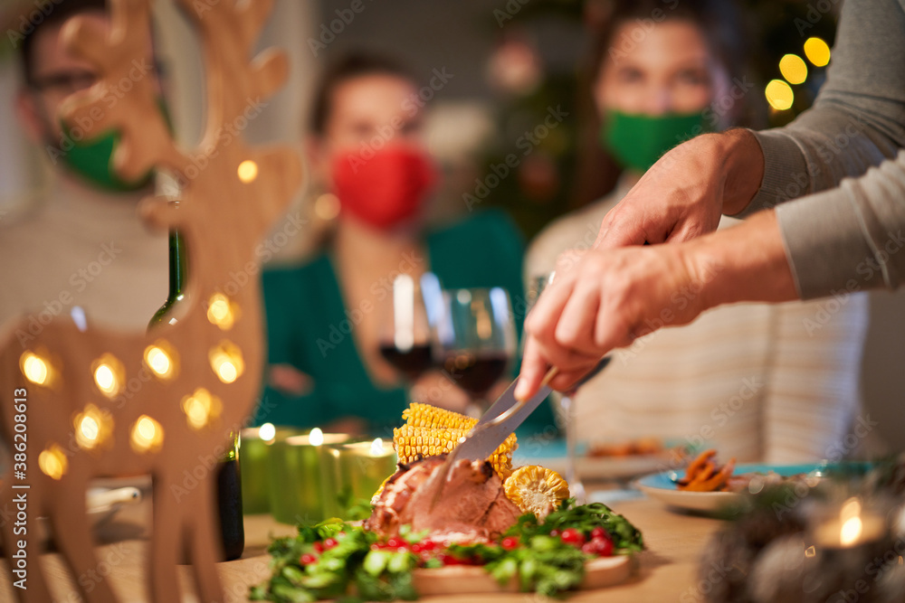 Fototapeta Christmas ham being served on the table