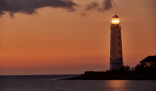 Beautiful Tall White Lighthouse At Sunset Crimea Peninsula Cape Fiolent