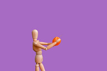 A Wooden Mannequin Holds A Phy...