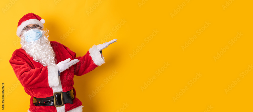 Fototapeta santa claus isolated on color background pointing to space
