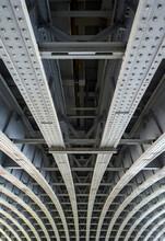 Beneath Blackfriars Railway Bridge In London, UK.  The Strong Steel Beams With Rivets Underneath The Bridge Hold The Structure In Place.  Blackfriars Railway Station Is Built On Top Of The Bridge.